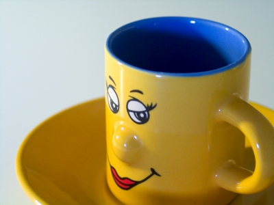 Espresso coffee cup with a smiling face on it